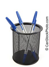 Ball point pens in a cup holder isolated against a white...