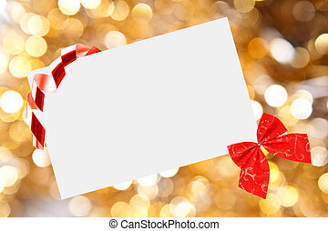 Christmas sheet of paper with bow and ribbons on yellow...