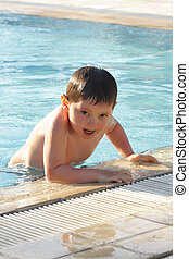 Boy in swimming pool - Boy going out of swimming pool