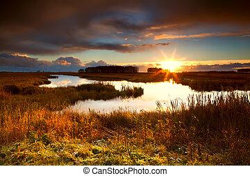 dramatic sunrise over lake - dramatic sunrise over pond...