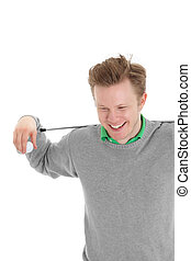 Golfer looking down - Happy golfer looking down holding a...