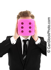 Businessman holding a large dice