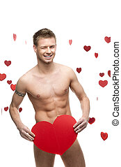 funny naked man holding big red paper heart - young cheerful...