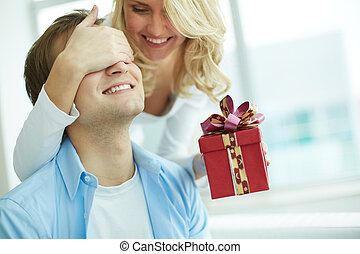 Congratulations - Image of young female with giftbox closing...