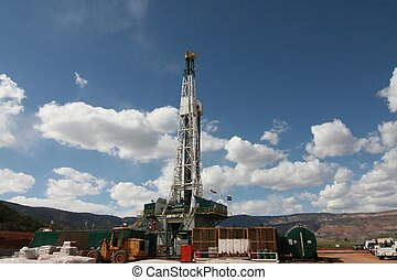 Oil Rig - Oil rig in the RockyMountains with blue sky and...