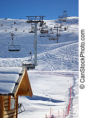 Skiing lift start 2 - Vertical photo of gondolas in a skiing...