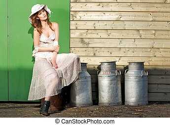 Beautiful Young Girl Sitting on Milk Jugs - Beautiful young...