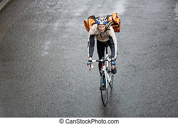 Male Cyclist With Backpack On Street - Young man in...