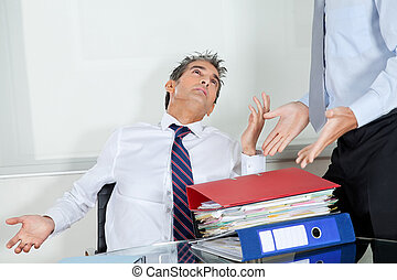 Businessmen Overwhelmed By Load Of Work - Mid adult...