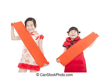 two chinese little girl holding blank red couplets - two...