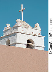 church tower made of adobe, in the Atacama desert, Chile