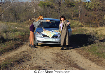 Two women looking at the road map