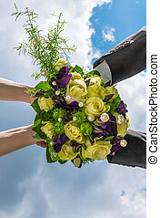 Bridal Bouquet - This image shows a bridal bouquet with arms