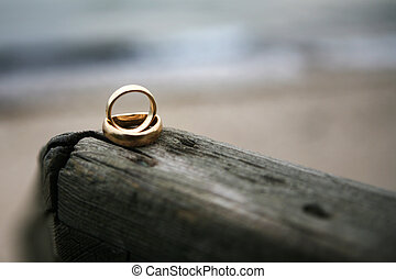 Wedding rings - Two wedding rings on top of each other lying...