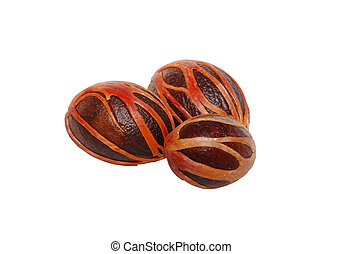 Three whole nutmeg seeds covered in mace, isolated on a...