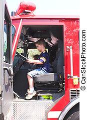 Boy Sitting In Fire Truck