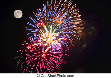 Fireworks at Full Moon - A fireworks display and a full moon...