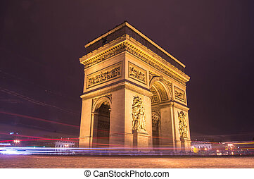 side vie of Arc de Triomphe in Paris at night - side vie of...