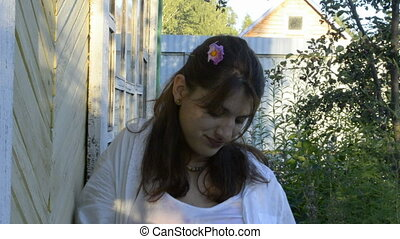 Young woman with flower in her hair