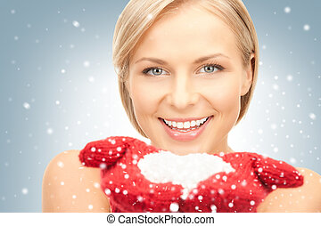 beautiful woman in red mittens with snow - picture of...