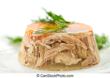 meat aspic - jellied meat and vegetables on a white...
