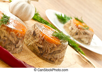 meat aspic - jellied meat and vegetables on a wooden...