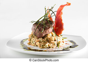 Gourmet piece of meat over a bed of mashed potatoes