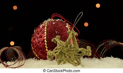 Christmas decorations rotating on dark background