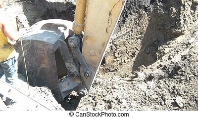 Backhoe Digs Cautiously After Ground Probed