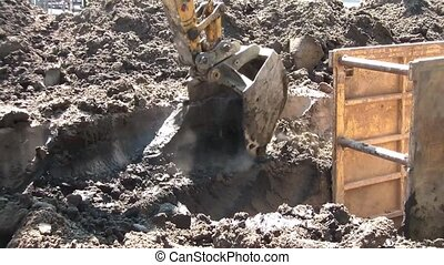 Backhoe Digs Dusty Dirt - Construction backhoe digs in dry...