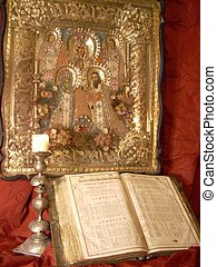 Religion still life with antique Bible and icons