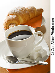 coffee - fresh croissant and coffee for breakfast close up