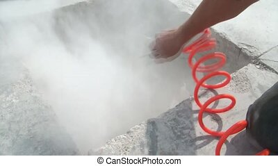 Blowing Dust with Air Hose - Worker blows dust with an air...