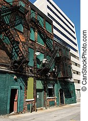 Inner city. - An old building from the back and a new white...