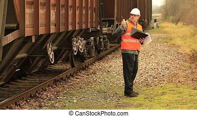 Railroad employee near  the wagons