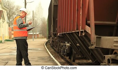 Engineer with folder at the station