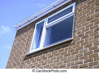 guttering and window on the front of a house against the...