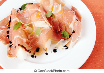 Prosciutto with melon on a plate