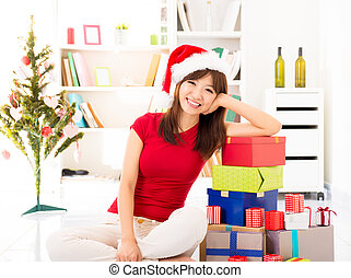 Christmas preparation - Happy Asian female leaning on stack...