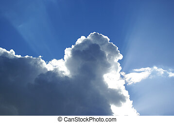 Rays behind a cloud.