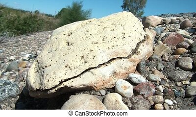 Broken in Half Abstract - Pale yellow rock is broken in half...
