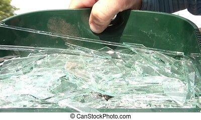 Broken Glass in Dustpan - Shiny sun reflects off of broken...