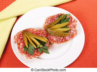 Pair of sandwiches with salami and cuke