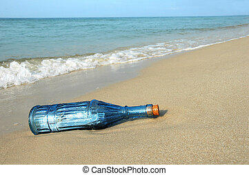 Bottle with Message on Shore - Bottle with message on a...