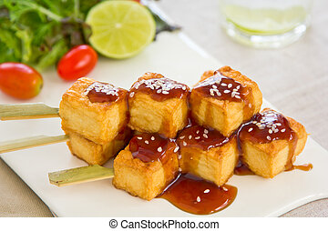 Barbecue Tofu with teriyaki sauce and salad
