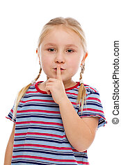 Little girl showing silence sign. Studio shot.