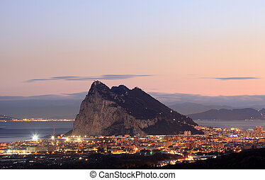 The Rock of Gibraltar and spanish town La Linea at night