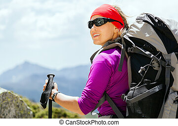 Woman hiking with backpack in mountains, Corsica France...