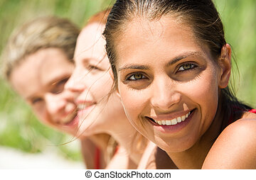 Row of girls - Row of face of three young smiling teens in a...