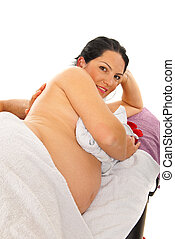 Pregnant woman receive back massage - Happy pregnant woman...